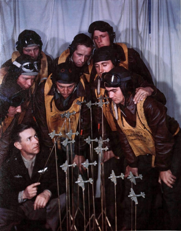 captain_jack_westwood_instructs_pilots_on_proper_combat_formation_england_1943.c0gvsll2o1kw80cwc4wss0wo8.ejcuplo1l0oo0sk8c40s8osc4.th.jpeg