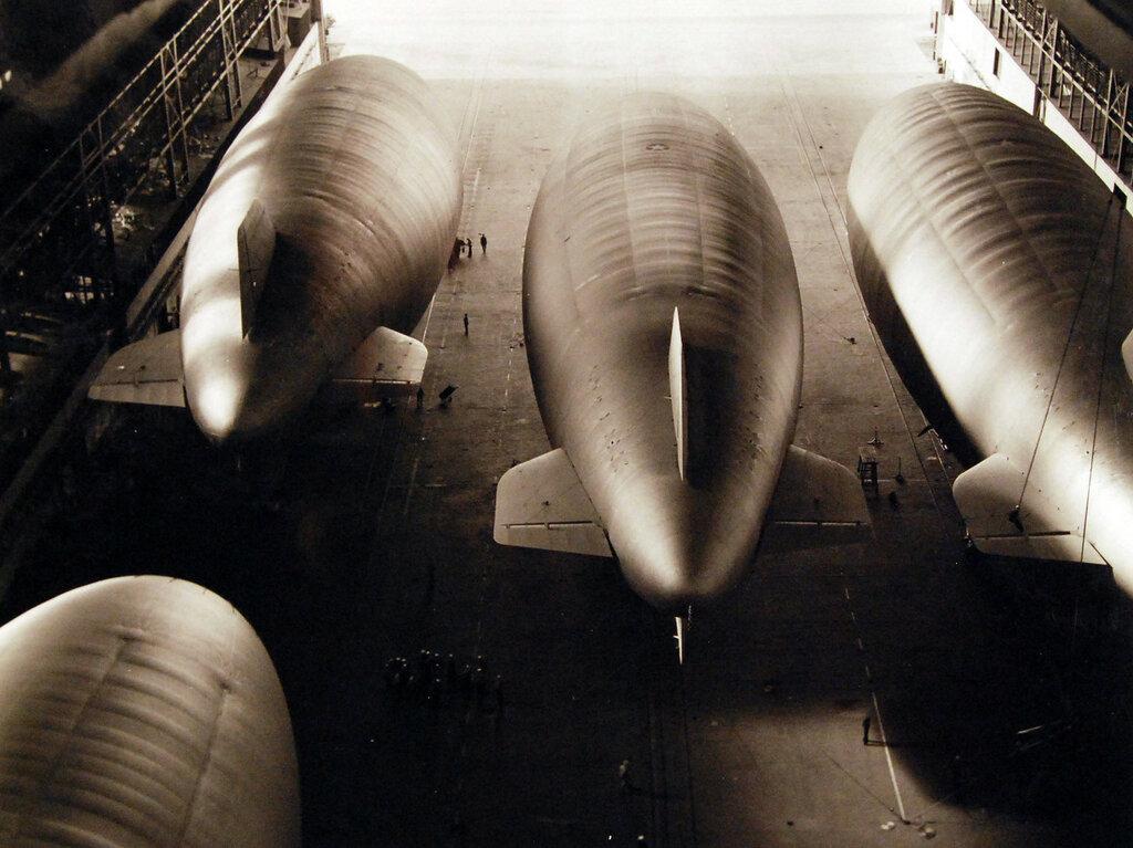 Naval Air Station, Lakehurst, New Jersey, October 1942. Four Navy K-Type Blimps, Lighter-than-Air Aircraft, in hangar.