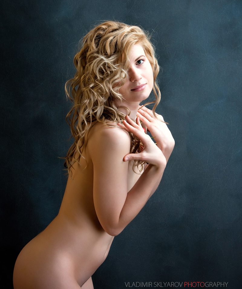 Young sexy blond woman with long curly hair