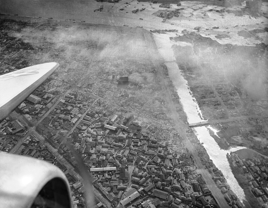 Smoke rises from enemy-held Pohang on the northern Korean front, August 16, 1950, in this aerial vie
