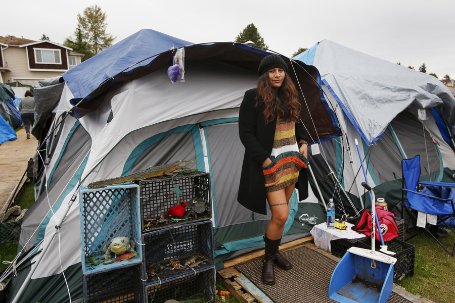 Kalaniopua Young, 32, originally from Hawaii, poses outside her tent at SHARE/WHEEL Tent City 3 near