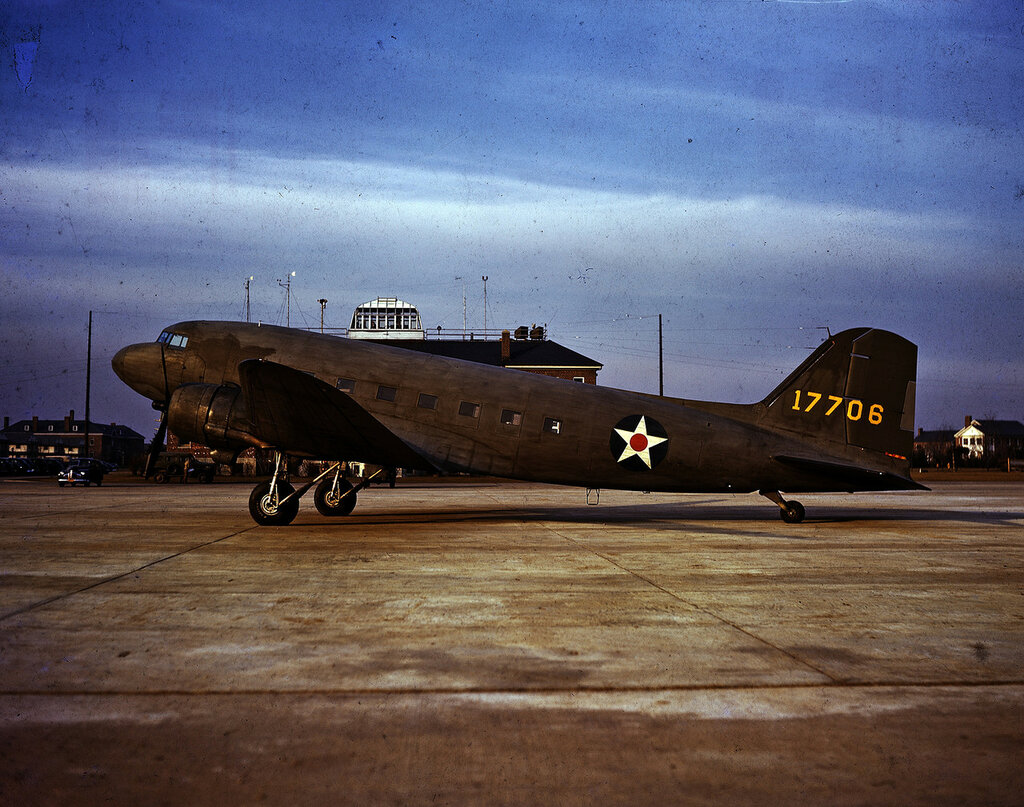 Left side view of U.S. Army Air Force Douglas C-52B Skytrain (s/n 41-7706) on the ground, 1942; aircraft was manufactured to be United Air Lines Douglas DC-3A (r/n NC 33648), but was used my U.S. Army Air Force