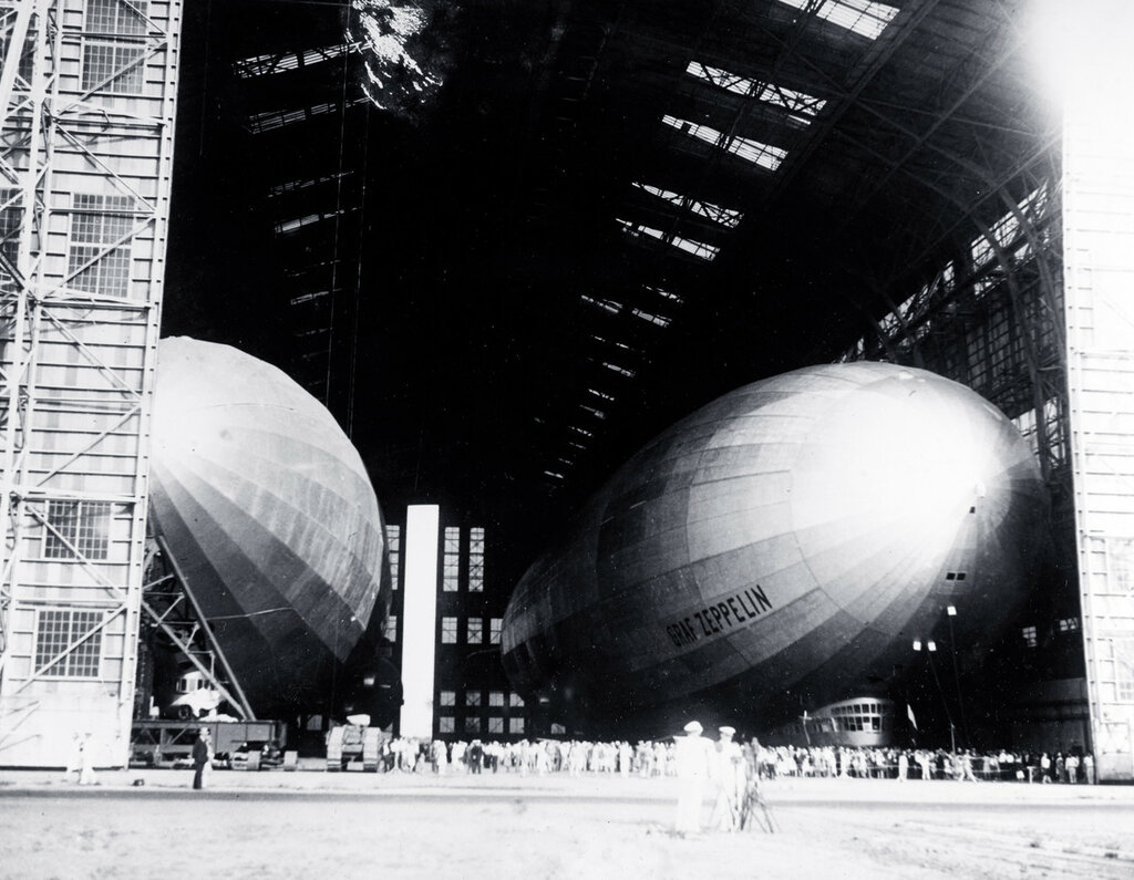 Graf Zeppelin (LZ-127) (at right) and USS Los Angeles (ZR-3), which had been built in Germany as  LZ-126. In the airship hangar at Naval Air Station Lakehurst, New Jersey. 7 August 1929