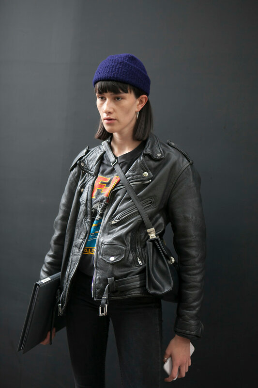 LONDON, ENGLAND - September 15, 2017 A guest wearing black leather jacket, beanie, skinny denim jeans, ankle boots during London Fashion Week September 2017 outside Eudon Choi