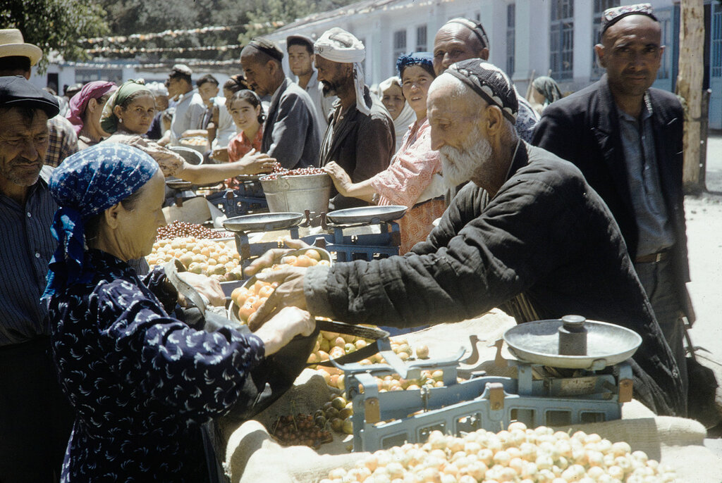Uzbekistan, merchant selling goods at Samarkand market