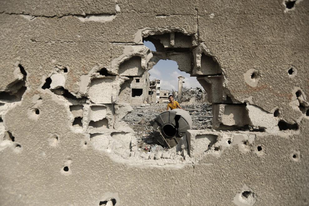 12. Спустя ровно месяц с момента начала операции «Нерушимая скала» некоторые районы города Газа выгл