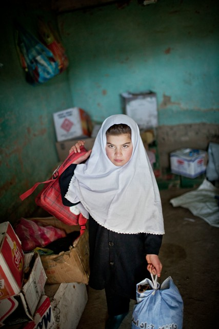 Tamana Mirwais, 10 years, changing every day before or after school (depending on whether she has lesson in the morning or in the afternoon) from girl clothes to boys' wear, or viceversa, in a store near her girls' school.