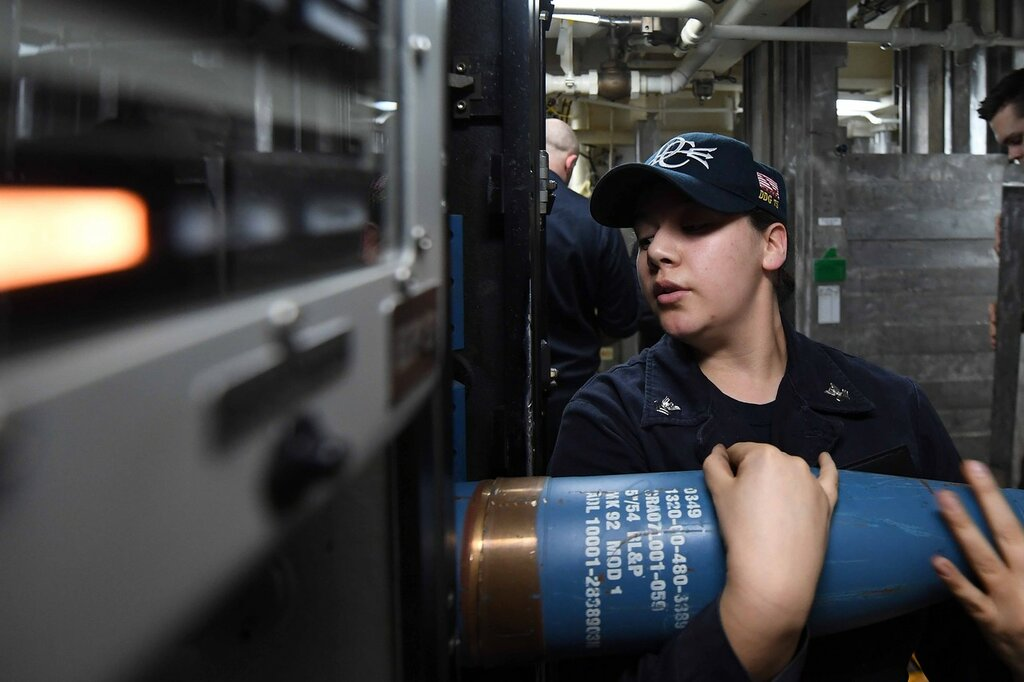 ATLANTIC OCEAN (March 14, 2017) - Gunner's Mate 2nd Class Samantha Canchola loads ammunition in a Mark 45 5-inch gun aboard USS Donald Cook (DDG 75)