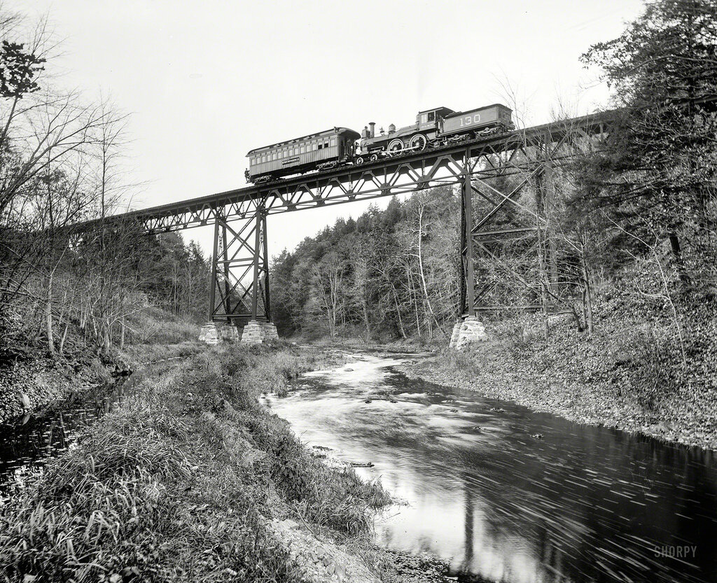 Circa 1900. Detroit Photographic car crossing DL&W bridge over the Passaic at Millington, New Jersey.