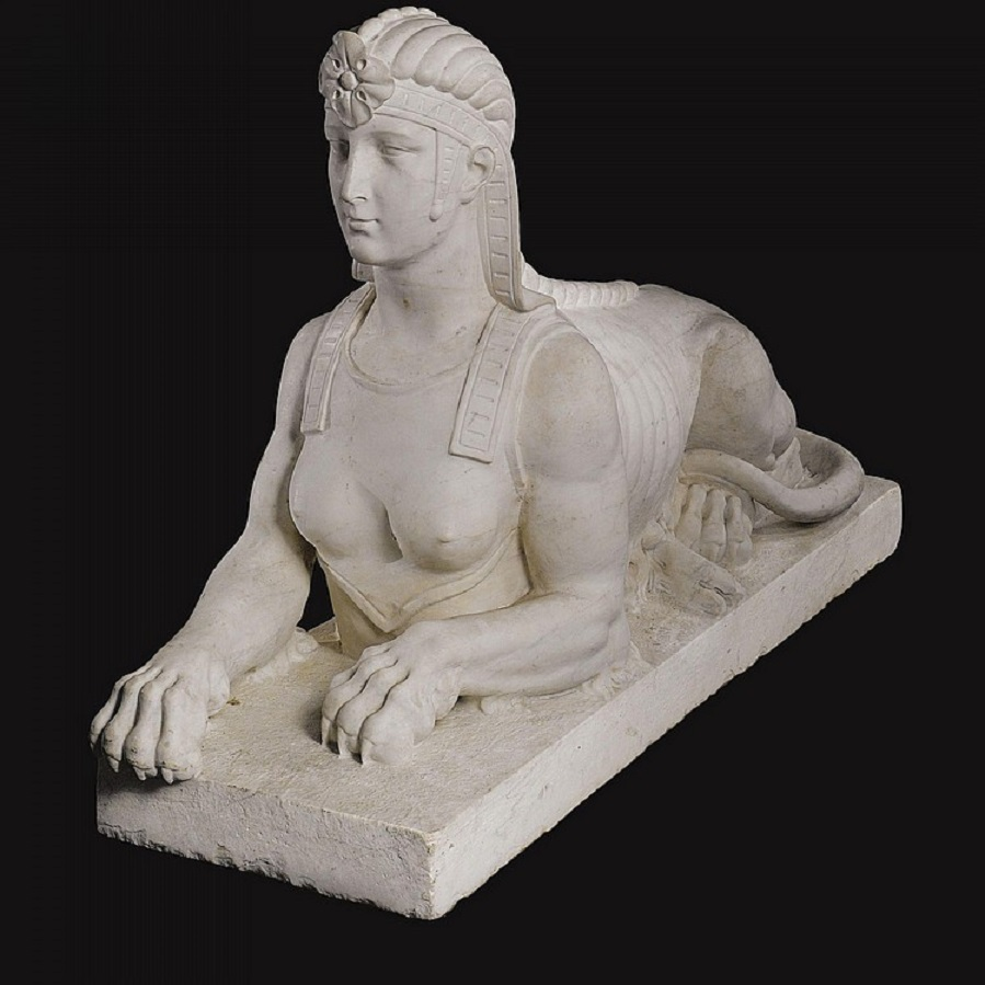 A large pair of carved white marble sphinxes..jpg