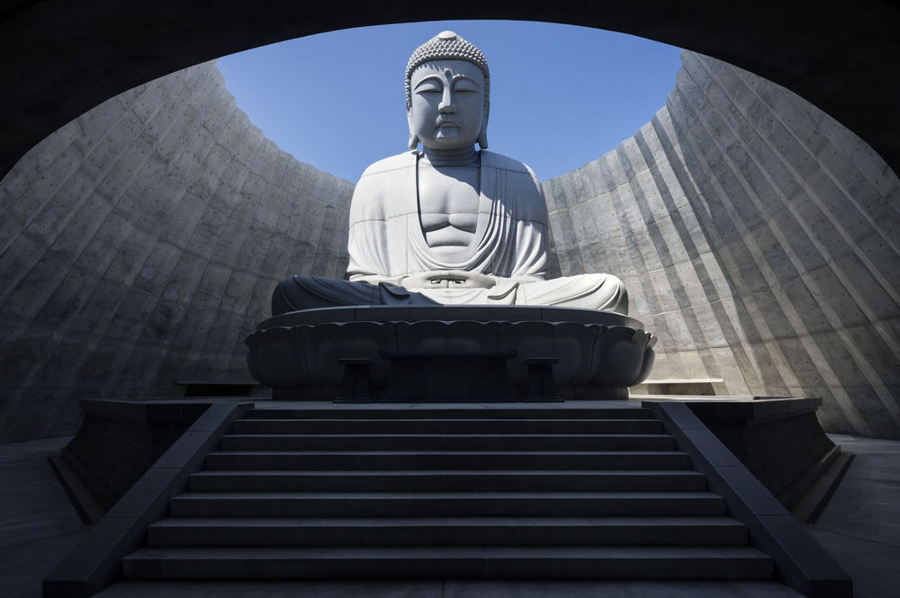 A Gigantic Buddha Statue Emerges from the Top of a Hill in Japan