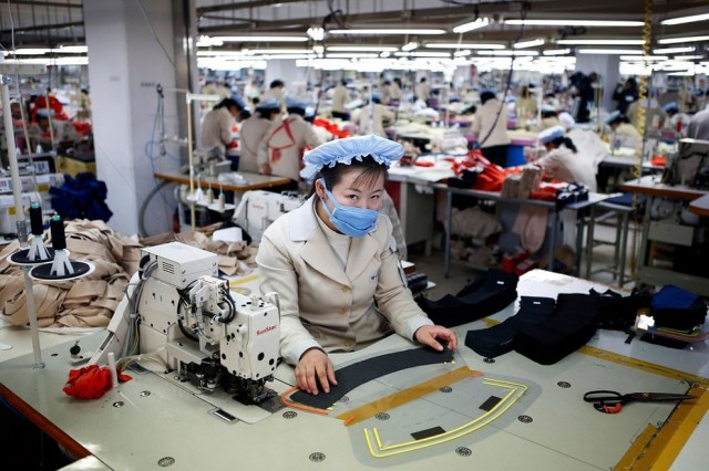 A North Korean employee works in a factory of a South Korean company at the Joint Industrial Park in