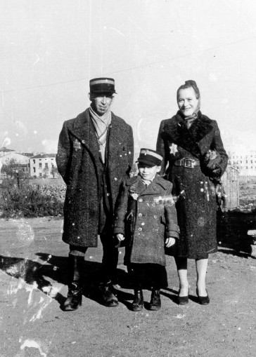 An officer of the Jewish ghetto police force in the Lodz ghetto, with his wife and son..jpg