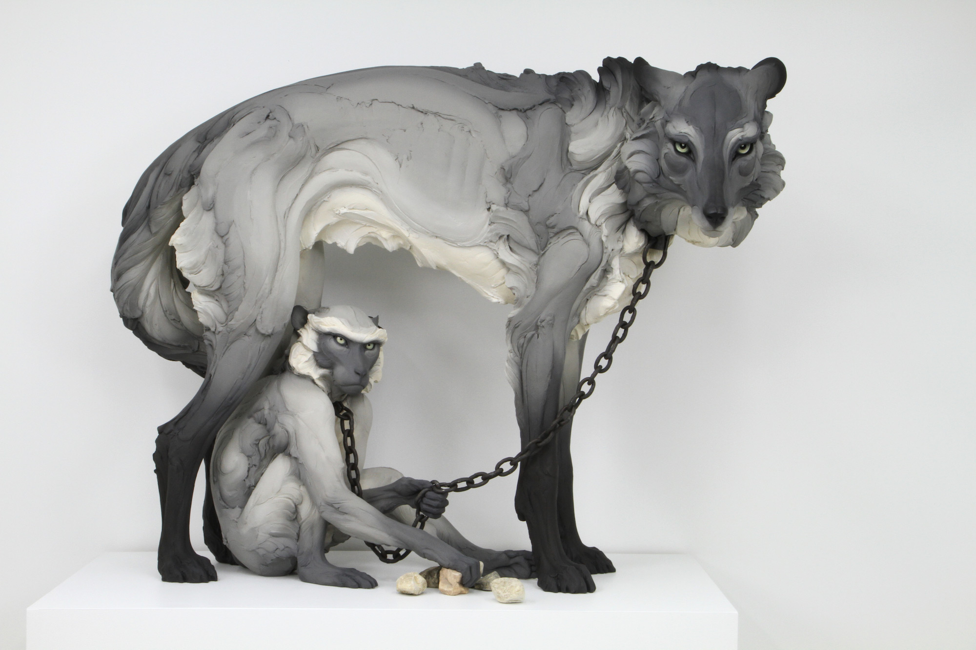 Tribute (Wolf and Monkey) , 2017. Stoneware, paint, hand-forged steel collars and chain. 46h x 58w x