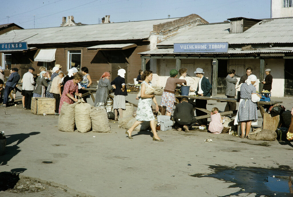 Russia, people gathered at street market. Siberia