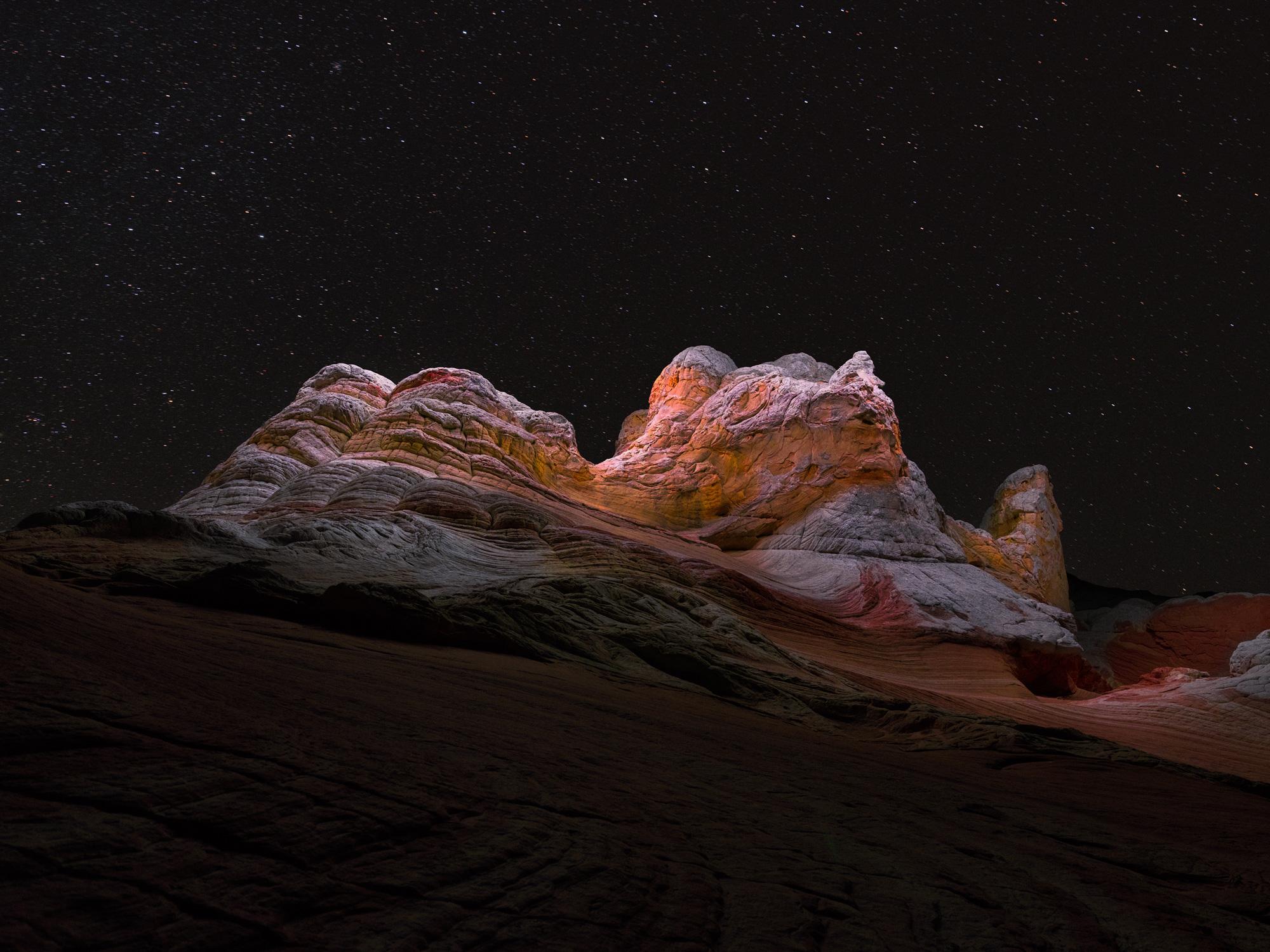 Long Exposure Photos Capture the Light Paths of Drones Above Mountainous Landscapes