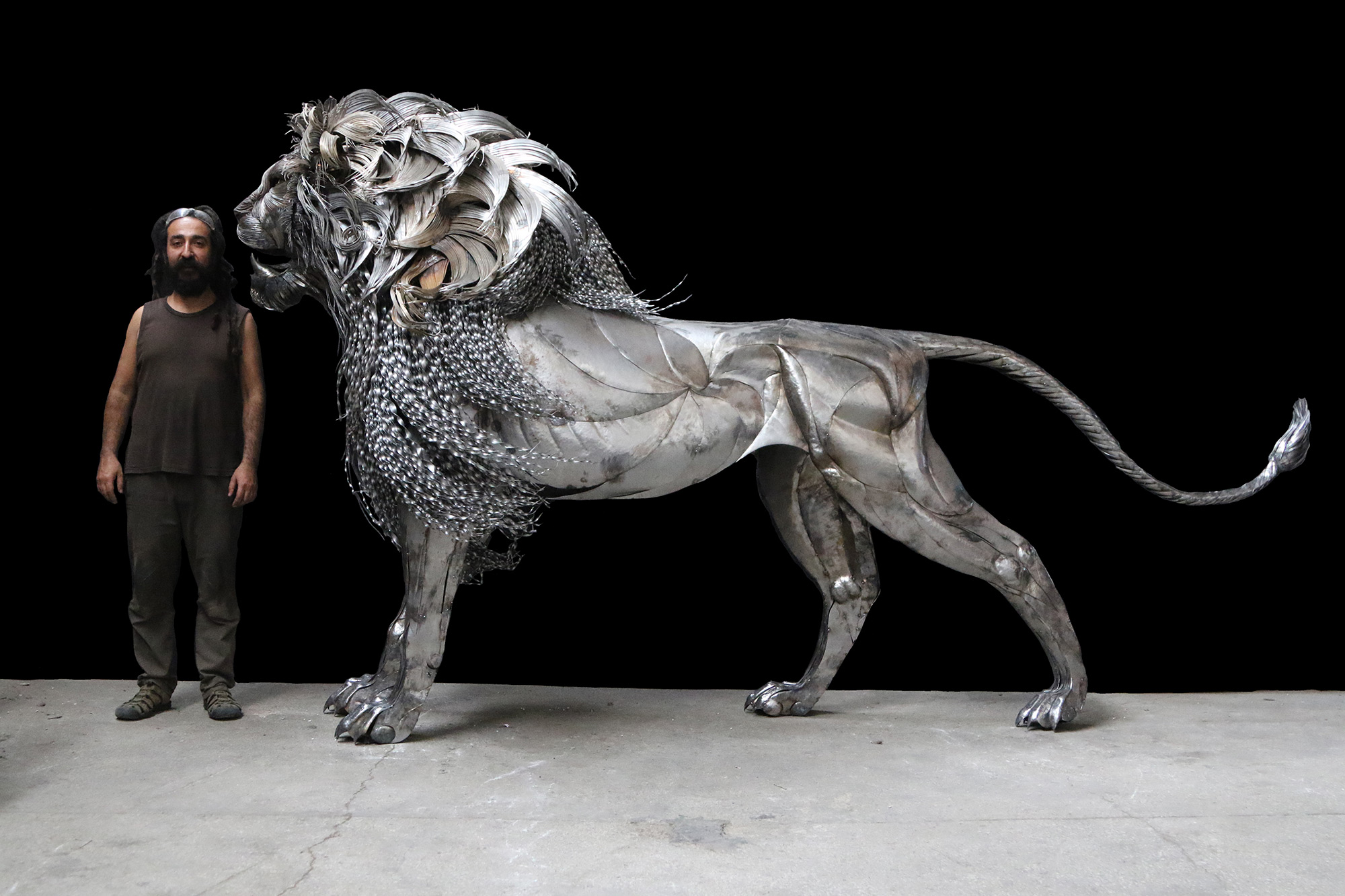 A Towering Hammered Steel Lion by Selcuk Y?lmaz