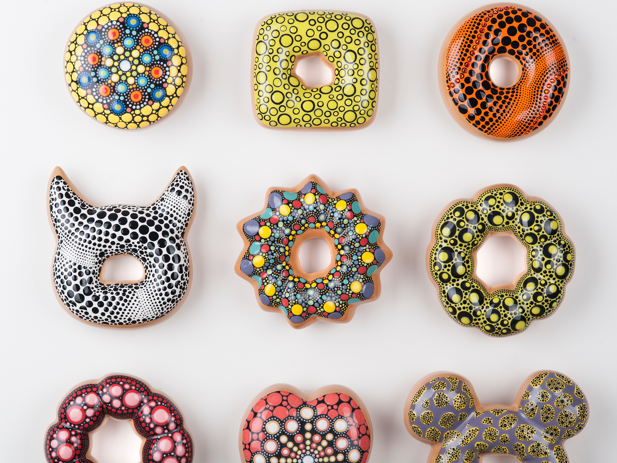 South Korean ceramicist Jae Yong Kim creates deliciously glazed donuts out of clay, glitter, and swa
