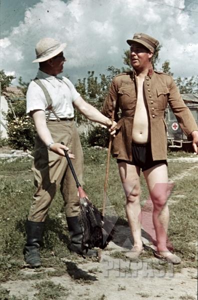 stock-photo-afrika-korp-officers-joke-around-with-captured-italian-officer-uniform-north-africa-1942-9803.jpg