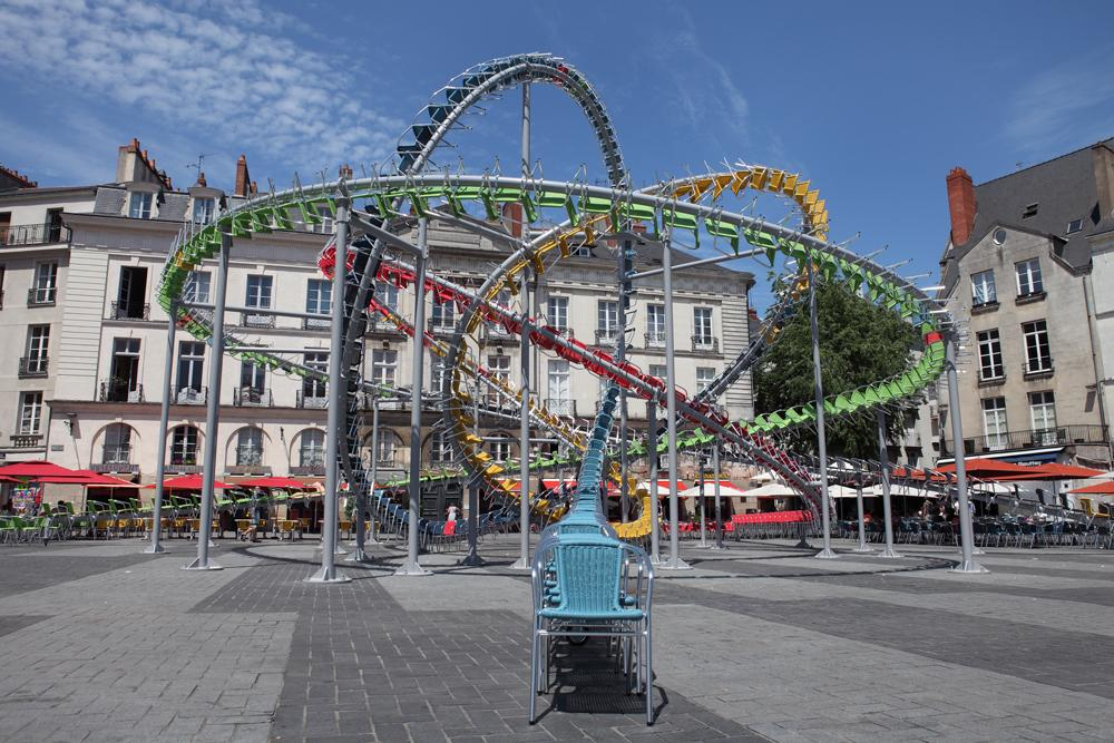 Hundreds of Colorful Cafe Chairs Take the Form of a Winding Roller Coaster in the Middle of a French Square (8 pics)