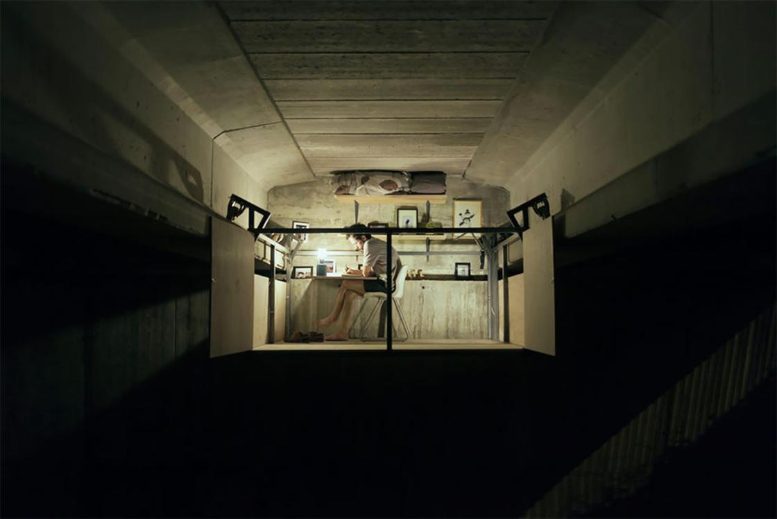 This designer built a studio hidden under a bridge