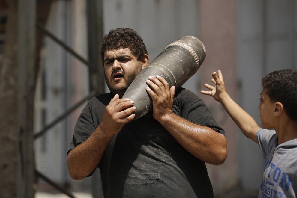18. Город Бейт-Лахия на севере сектора Газа, 5 августа 2014. (Фото AP Photo | Lefteris Pitarakis):