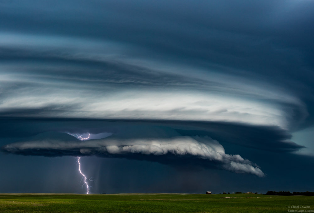A supercell thunderstorm approaches a farm in North Dakota on June 9, 2016 with the severe outfl