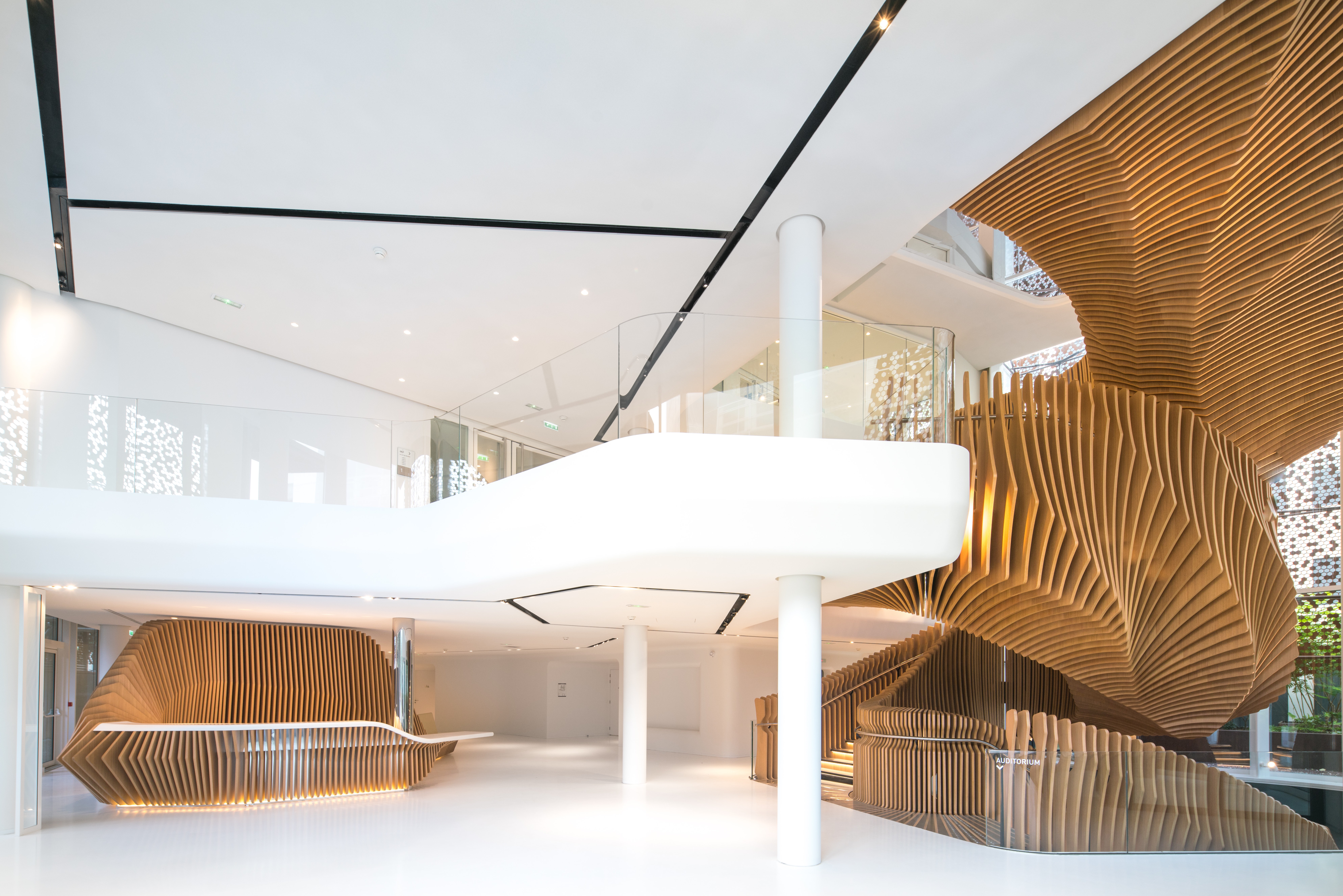 Sculptural Wood Staircase In LVMH Office by Ora Ito