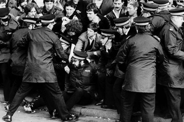 Picketing-miners-break-a-police-cordon-during-the-1984-strike.jpg