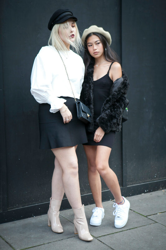 LONDON, ENGLAND - September 15, 2017 Beautiful and stylish women in black and white posing during the London Fashion Week. outside Eudon Choi