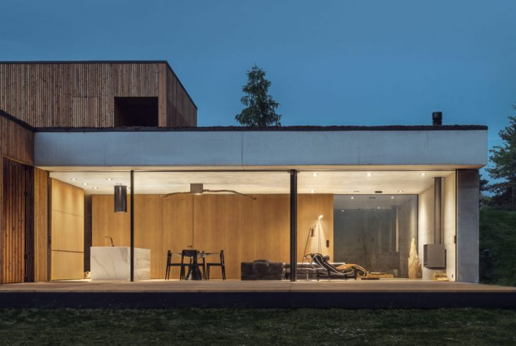 Studio de.materia  designed this inspiring modern retreat surrounded by forest and s