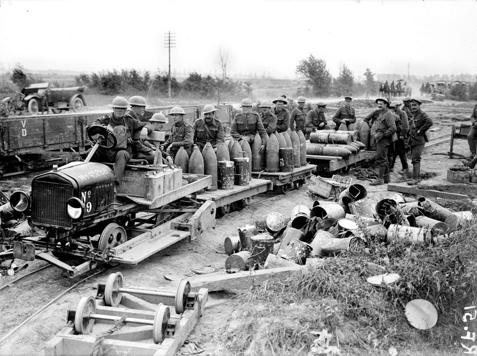 The Royal Garrison Artillery at Elverdinghe. Taking up shells by motor-driven light railway during the Battle of Langemarck, 19 August 1917.