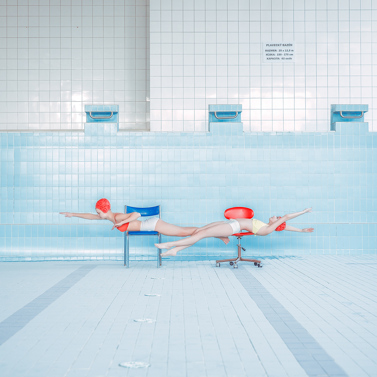 Synchronistic Images Captured in Soviet Era Swimming Pools by Photographer Maria Svarbova