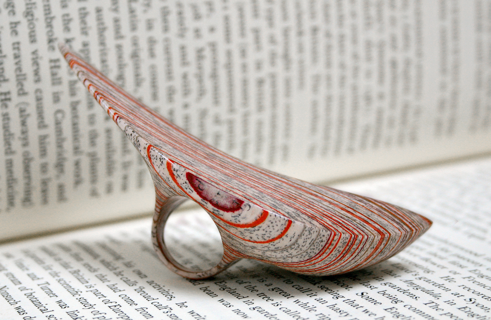 New work from literary jeweler Jeremy May ( previously ) transforms the dense layers of books into j