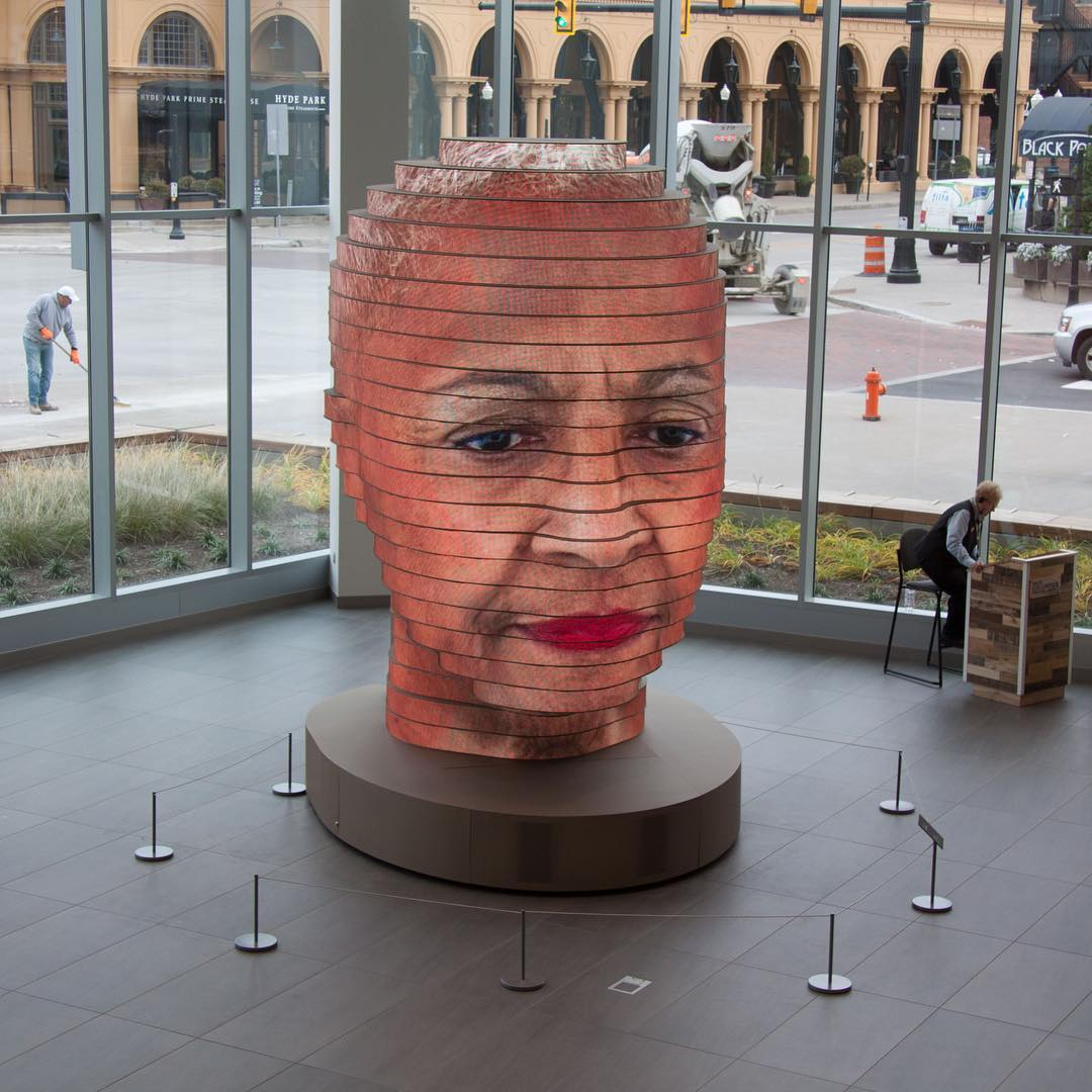 As We Are is a 14-foot interactive sculpture by artist Matthew Mohr . The head-shaped work slowly ro