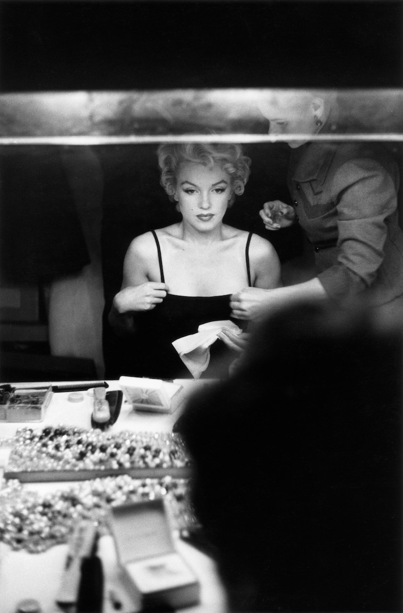 NEW YORK - 1955: Marilyn Monroe at a makeup table getting ready for an event in 1955 in New York, Ne