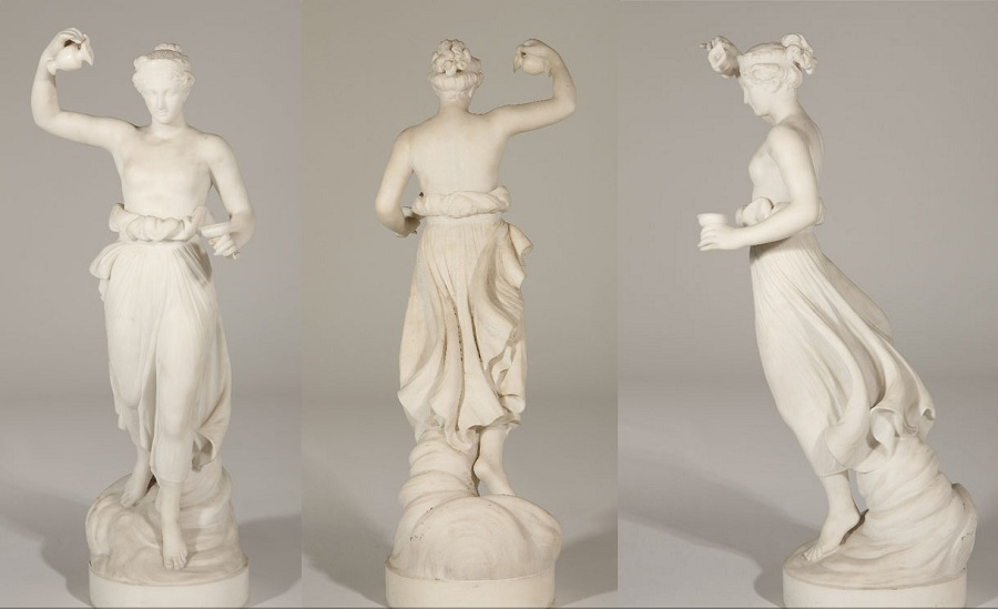 a scantily clad Classical woman holding a ewer and a cup, raised on a cloud over an integral circular base , 19th century