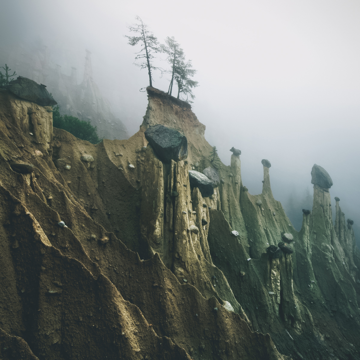 Otherworldly 'Earth Pyramids' Captured in the Foggy Early Morning Light by Photographer Kilian Schonberger (7 pics)
