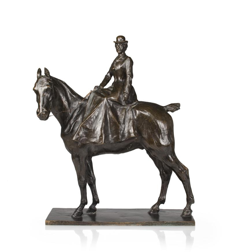 A patinated bronze sculpture of a woman on horseback