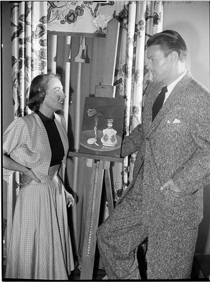1948. Джоан Кроуфорд разговаривает с мужчиной