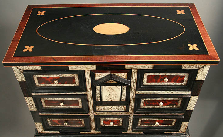 http://www.mfordcreech.com/17th_Century_Ebony_Ivory_Tortoiseshell_Collectors_Case_Details.htm