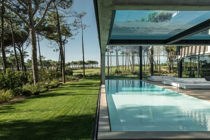 Guedes Cruz Architects   designed this inspiring concrete residence located in