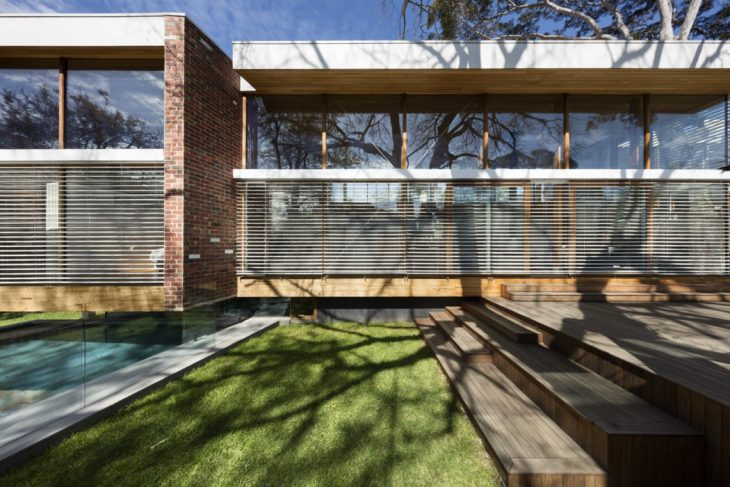 AM Architecture  designed this cozy modern residence located in Camberwell, Australi