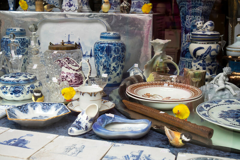 Showcases of Dutch shops with blue typical dishes and skulls