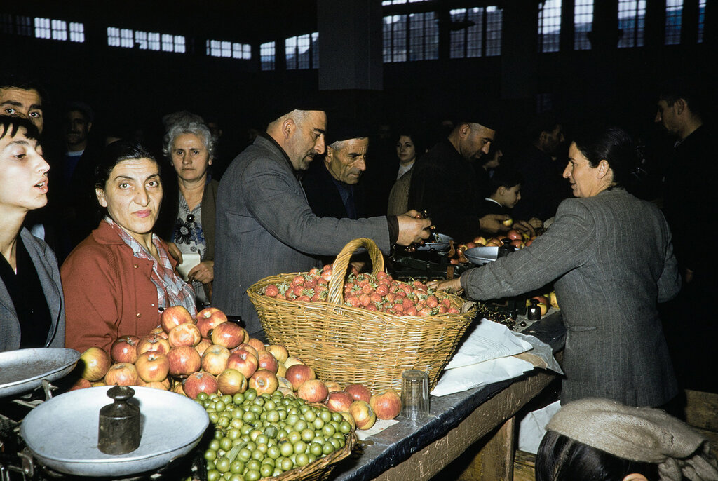 Russia, merchant selling fruit at market