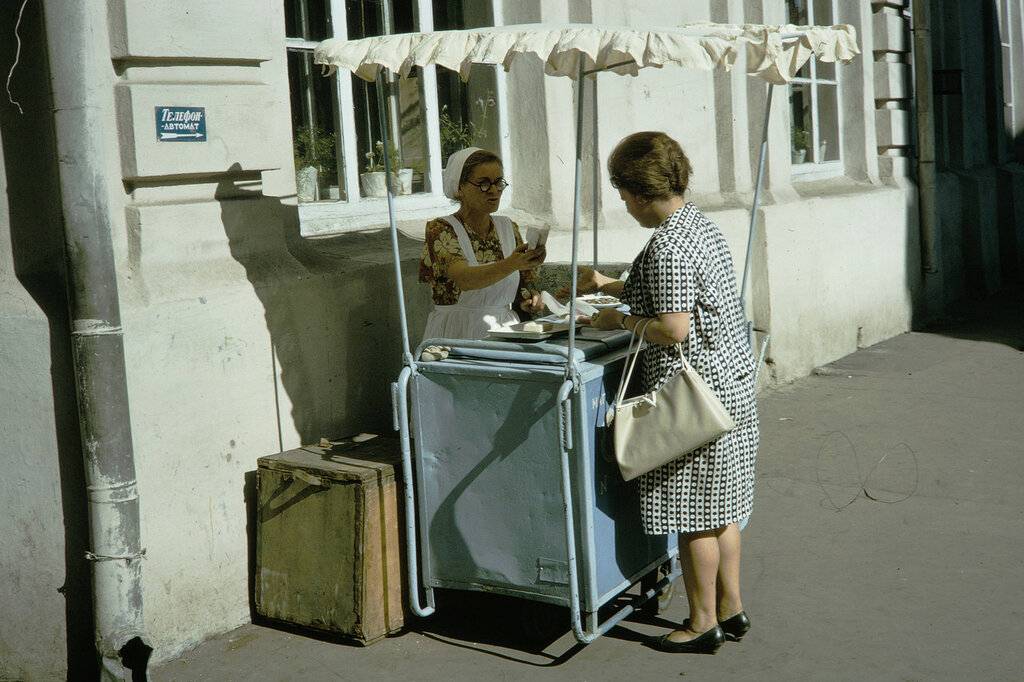 Russia, woman purchasing from ice cream vendor in Moscow