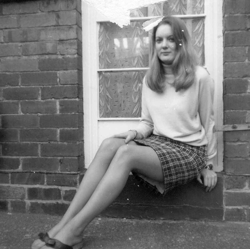 1968-10 Eve sitting outside at home in Shields Road