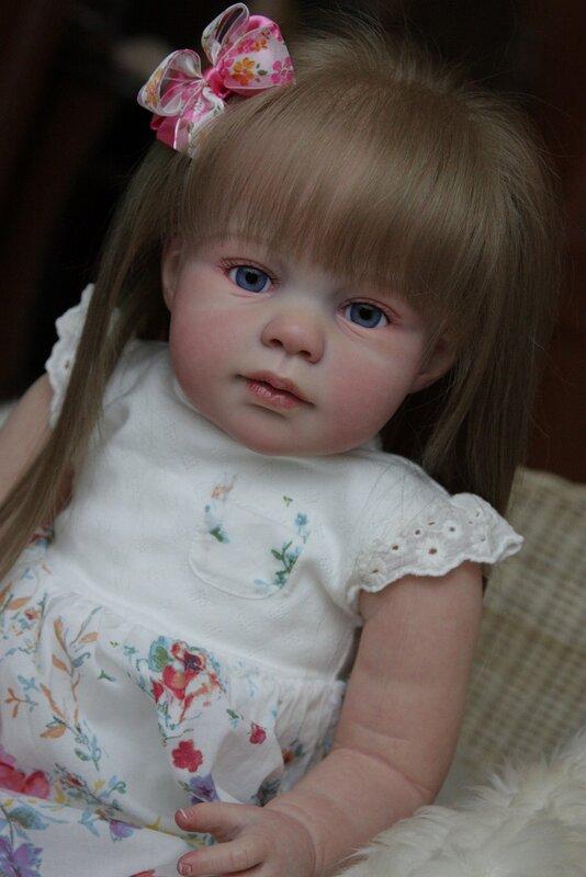 Кукла реборн с длинными волосами