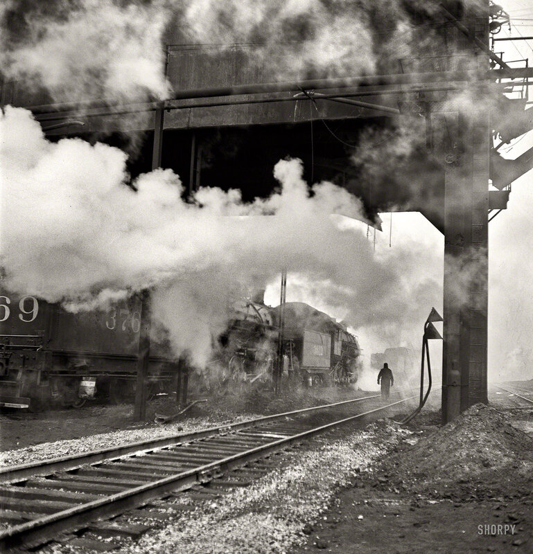 November 1942. 'Chicago. Locomotives loading up with coal, water and sand at an Illinois Central Railroad yard before going out on the road'