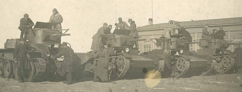 Soviet tankmen examining a group of T-26 tanks, 1931-39.